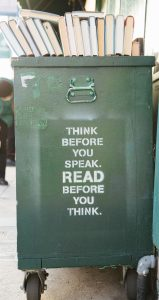 "green book bin with sign ""think before you speak, read before you think"" which is good advice for those trying to overcome emotional abuse."